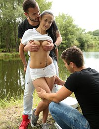 Chesty brunette teen Nicole taking two big pricks at lake